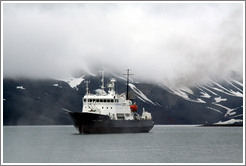 Polar Pioneer in front of the cloud-shrouded mountains of Deception Island.