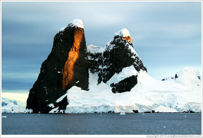Black, snow-covered mountains, Gerlache Strait