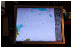 "Captain's GPS display showing the crossing of the Antarctic Circle, -66? 33' 7.05"", -67? 9' 7.94""."