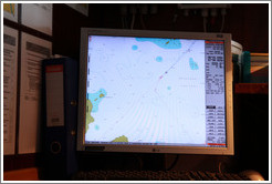 "Captain's GPS display showing the crossing of the Antarctic Circle, -66? 33' 3.39"", -67? 8' 9.23""."