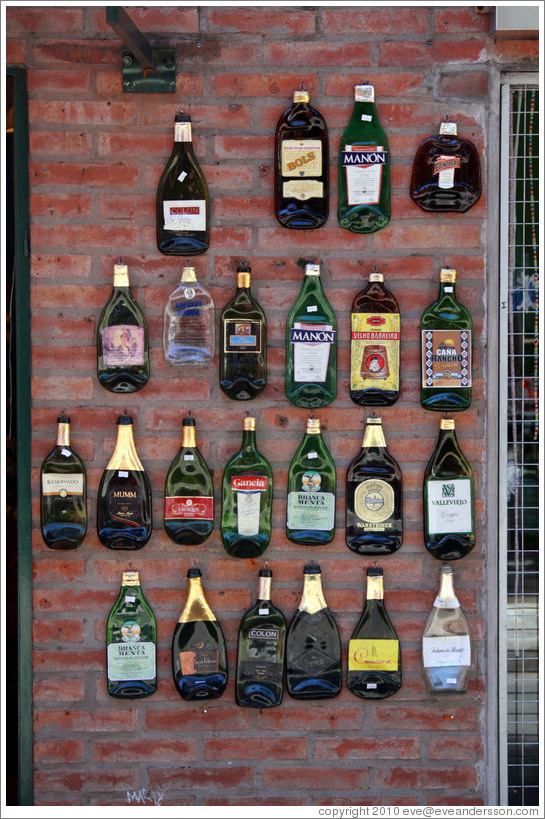 Flattened bottles on a wall. Russel, Palermo Soho.