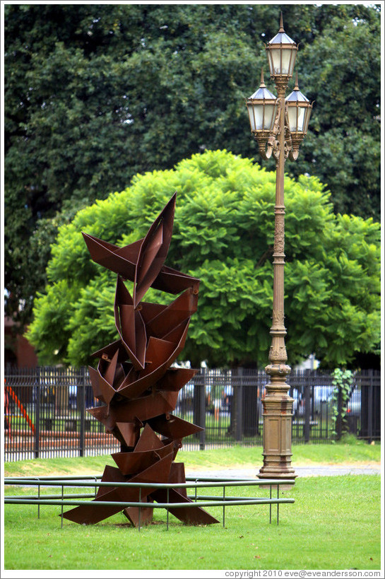 Sculpture and lamp post, Plaza Urquiza, Recoleta district.