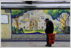 Man in front of a mural, Independencia station, Subte (Buenos Aires subway).