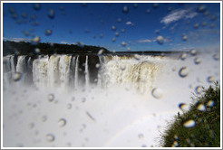 Spray from the Iguazu Falls at Garganta del Diablo, with a rainbow.