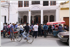 People waiting outside of Fundaci�n Madre Teresa de Calcuta.
