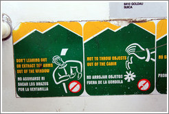 "Sign inside the telef�rico with interesting English translations: ""Don't leaning out or extract the arms out of the window"" and ""Not to throw objects out of the cabin""."