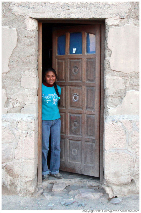 Girl in a doorway.