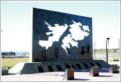 "Malvinas memorial which reads, ""El pueblo de Ushuaia a quienes ... con su sangre regaron las raices de nuestra soberania sobre Malvinas ... volveremos!!!""  Translation: ""The town of Ushuaia who ... with their blood watered the roots of our sovereignty over Malvinas ... we will return!!!"""