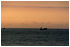 Boat seen from Ipanema at sunrise.