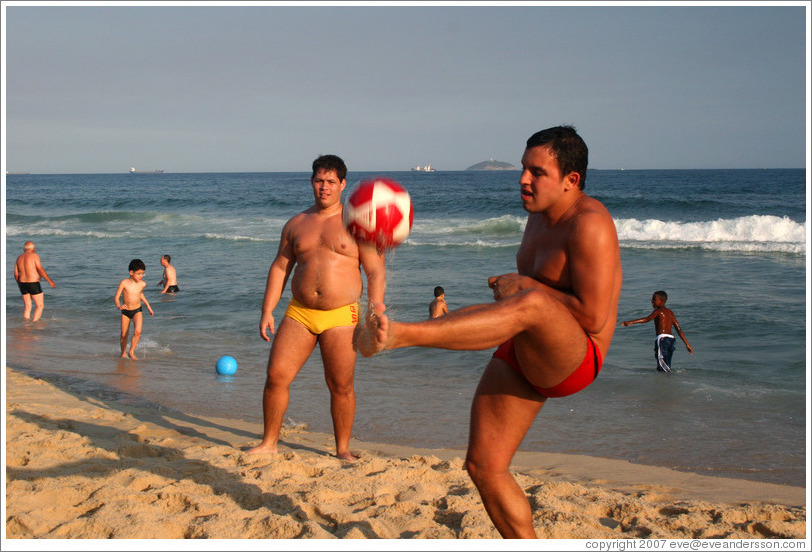 Man playing soccer on Ipanema Beach.