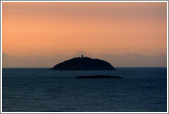 Island with lighthouse at sunrise, viewed from Ipanema.