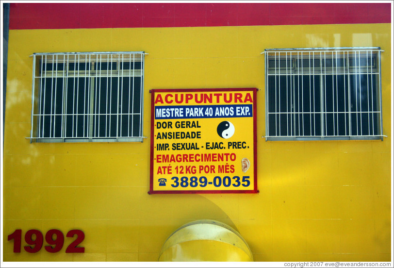 Sign advertising acupuncture as a cure for  impotence and premature ejaculation.