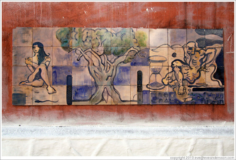 Artwork: woman, tree, hourglass, man.  Wall surrounding the Cemit?o S?Paulo.