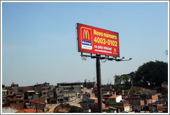 Billboard advertising McDonald's in front of a favela near São Paulo.