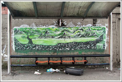 Graffiti at a bus stop: green mountains and trees.  Av. Pres. Juscelino Kubitschek at Rua Dr. Renato Paes de Barros.