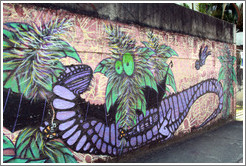 Graffiti: purple lizard and green plant with eyes.  Av. Quarto Centen?o at Rua Leiria.