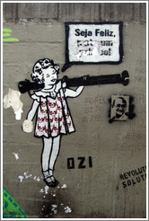 "Graffiti: girl with skulls on her dress saying ""Seja Feliz"".  Created by graffiti artist Ozi.  Av. Brg. Lu?Ant? at Pra?Dom Gast?Liberal Pinto."