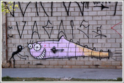 Graffiti: pink fish in love with a black squiggle.  Rua Olimp?as.