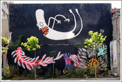 Graffiti: leaping white ghost and pink fish.  Rua Olimp?as.