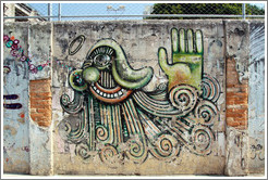 Graffiti: green cyclops with hand.  Villa Magdalenda neighborhood.  Rua Ant? Bicudo near Rua Benjamin Egas.