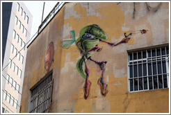 Graffiti: flying green insect with slingshot.  Villa Magdalenda neighborhood.  Rua Belmiro Braga and Rua Cardeal Arcoverde.