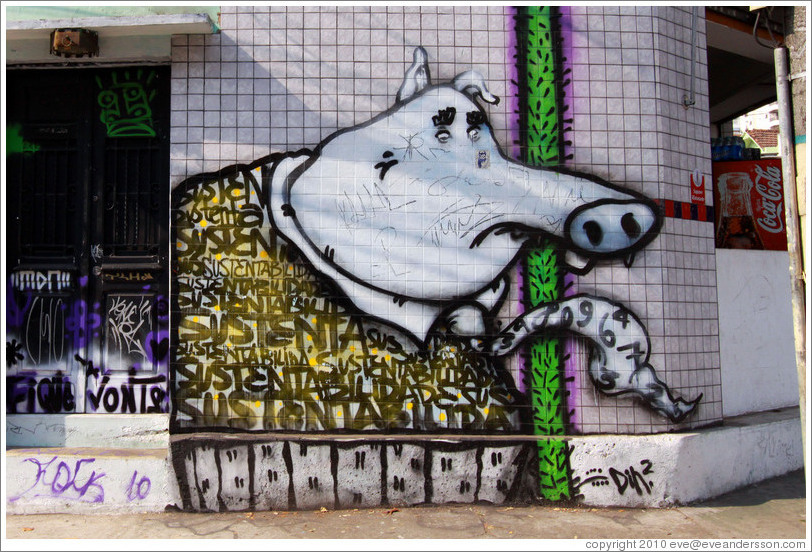 Graffiti: sad pig wearing a tie with numbers on it.  Villa Magdalenda neighborhood.  Rua Belmiro Braga and Rua Cardeal Arcoverde.