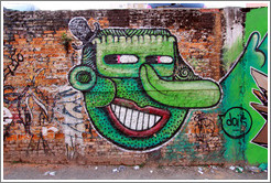 Graffiti: Frankenstein-like face with large nose and small top hat.  Villa Magdalenda neighborhood.  Rua Cardeal Arcoverde.