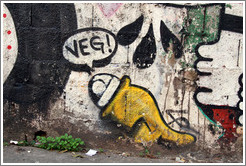 "Graffiti: yellow creature saying ""Veg!"".  Villa Magdalenda neighborhood.  Rua Cardeal Arcoverde."