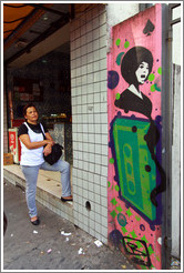 Graffiti: woman with a large, green cassette tape.  Villa Magdalenda neighborhood.  Rua Cardeal Arcoverde.