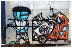 Graffiti: blue man pulling a cart.  Villa Magdalenda neighborhood.  Rua Padre Jo?Gon?ves near Rua Fradique Coutinho.