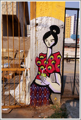 Graffiti: woman with hair in a bun.  Villa Magdalenda neighborhood.  Rua Padre Jo?Gon?ves near Rua Fradique Coutinho.