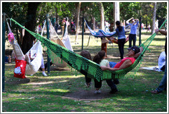 People relaxing in hammocks.  Parque do Ibirapuera.