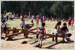 People playing on seesaws.  Parque do Ibirapuera.