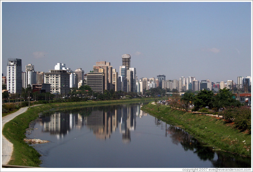 São Paulo skyscrapers, reflected in river.