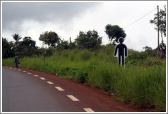 Sign depicting human figure at the side of the road.  Indicates that someone died there in a traffic accident.