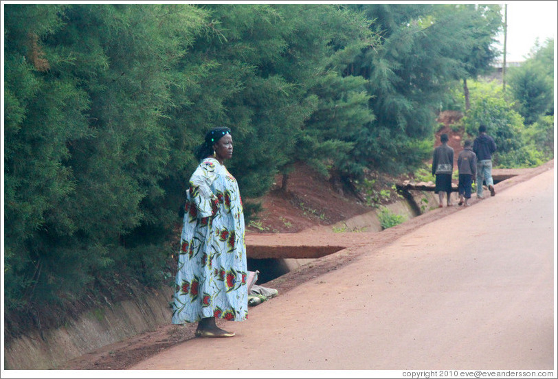 Woman at side of road.
