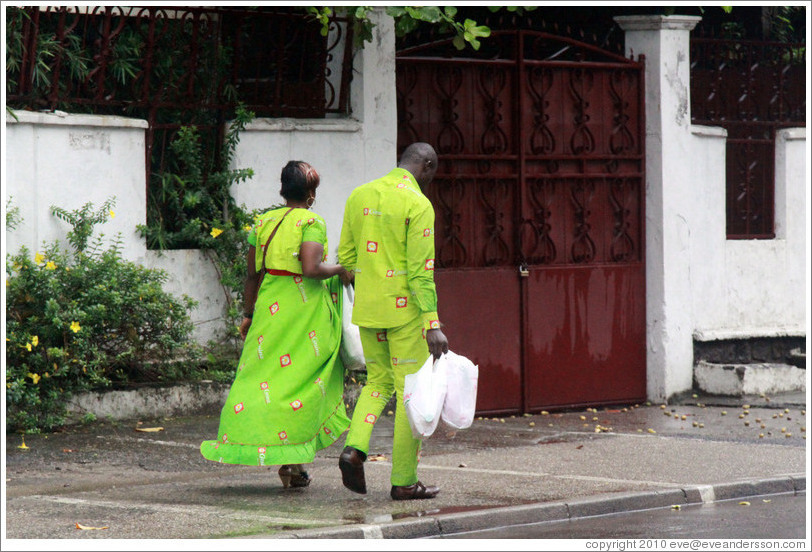 Woman and man in matching green clothing.