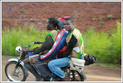 Three men on a motorcycle on Route N5.