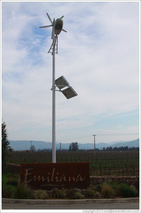 Sign, with a solar and wind powered light over it.  Emiliana Vineyards.