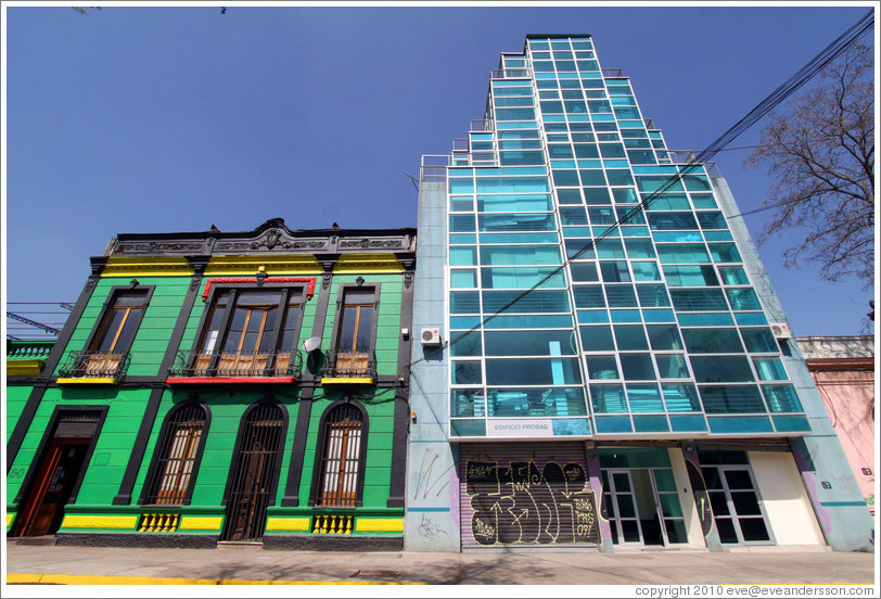 Old building (green, black, yellow, red) and new building (blue glass).  Dardignac, Bellavista.