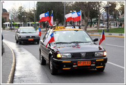 Taxi with eight Chilean flags.