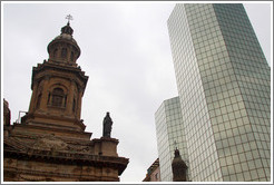 A tower of the Cathedral Metropolitana and a modern building, Plaza de Armas.