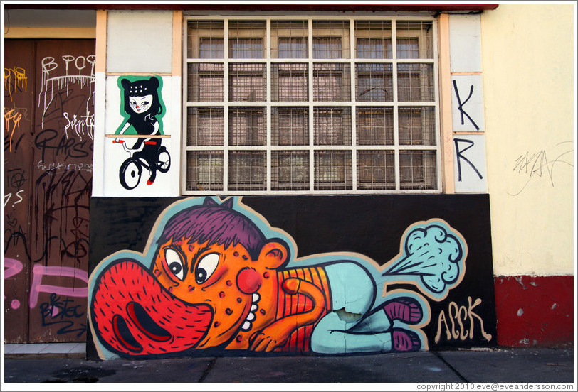 Graffiti: feline woman riding a bicycle and porcine man farting.  Dardignac, Bellavista neighborhood.