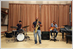 Musicians performing at Abdala Studios, including Oliver Valdés on drums and Carlos Miyares on saxophone.