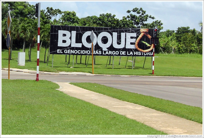 "A sign near the airport reading, ""Bloque. El genocidio más large de la historia."" This refers to the United States' trade embargo against Cuba, saying it's the longest genocide in history."