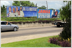 "Signs near José Martí Airport: ""Fin a la Injusticia"" (""End to the Injustice"") referring to the Cuban Five; and ""Jam?un pueblo tuvo tantas cosas que defender ni convicciones tan profundas con las cuales luchar"" (""Never has a people had such things to defend nor convictions so profound with which to fight"")."