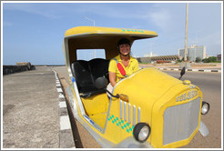 Alba, driver of a Coco taxi, on the Malecón.