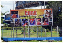 "Billboard in front of the Coliseo de la Ciudad Deportiva sporting arena: ""Cuba campeones del pueblo"" (""champions of the people"")."