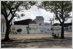 "Graffiti of a fish/person/bee with the words ""el gran zoo"" (""the big zoo""), a robot, and other creatures, Avenida Salvador Allende (Carlos III)."