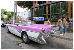 Pink and white car, corner of 21st Street and O Street.